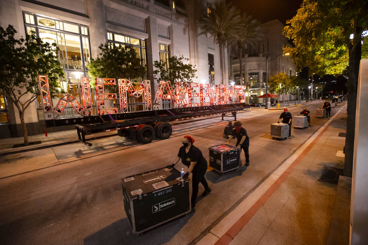 """Entertainment workers push road cases past a """"We Make Events"""" sign as The Smith Cente ..."""