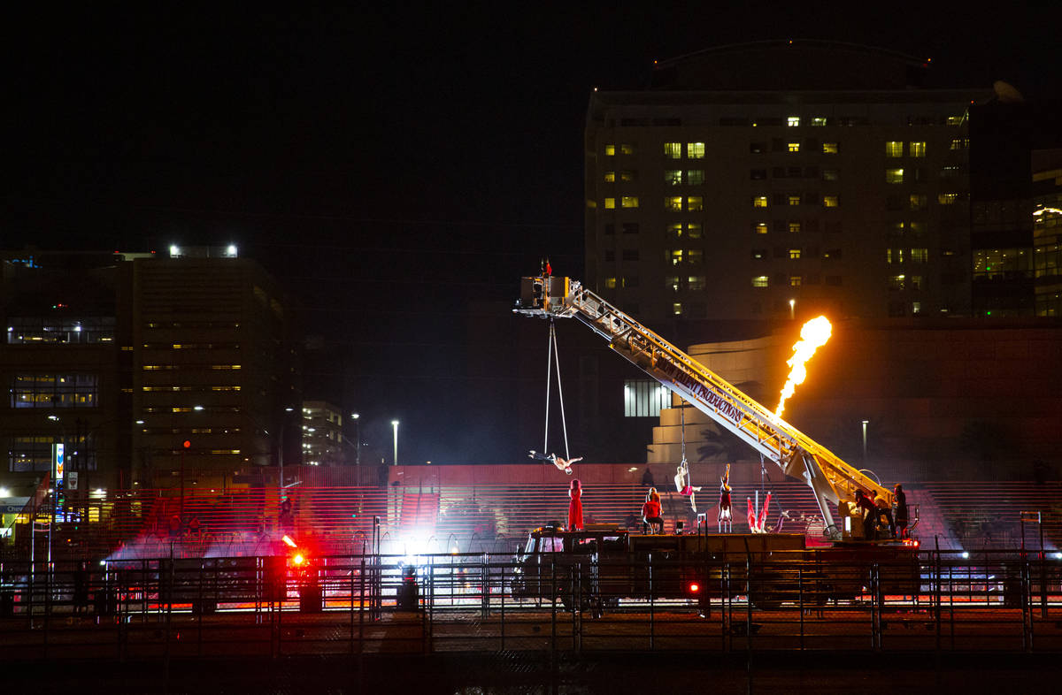 """People perform at the Core Arena at the Plaza for the """"Red Alert"""" campaign in downtow ..."""