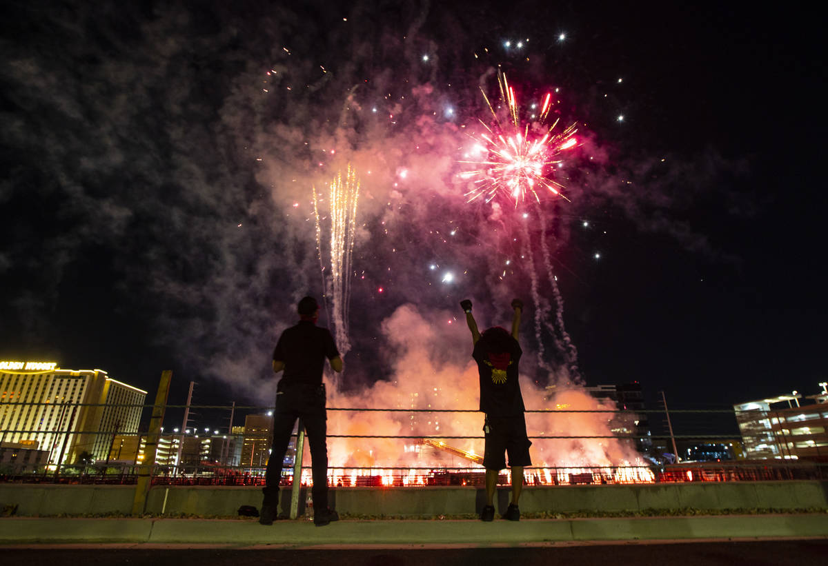 """Entertainment workers watch as fireworks go off at the Core Arena at the Plaza for the """"Re ..."""