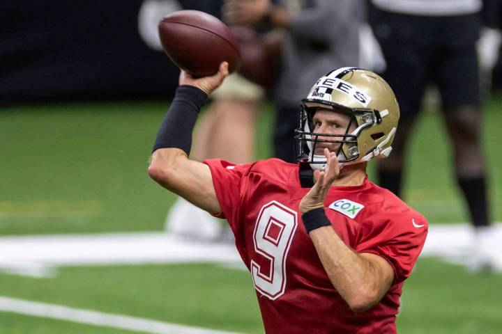 New Orleans Saints quarterback Drew Brees throws the ball during NFL football training camp Sat ...