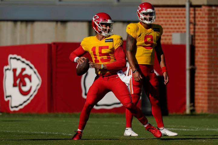 Kansas City Chiefs quarterback Patrick Mahomes throws while quarterback Jordan Ta'amu (9) watch ...