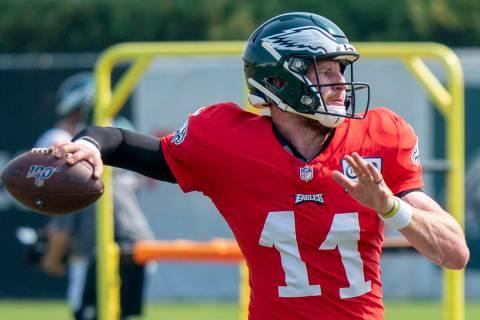 Philadelphia Eagles quarterback Carson Wentz in action during an NFL football practice, Thursda ...