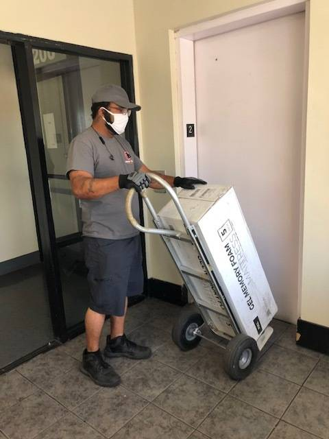 Move 4 Less mover Drew Potts transported new beds into HELP of Southern Nevada's seven clients' ...