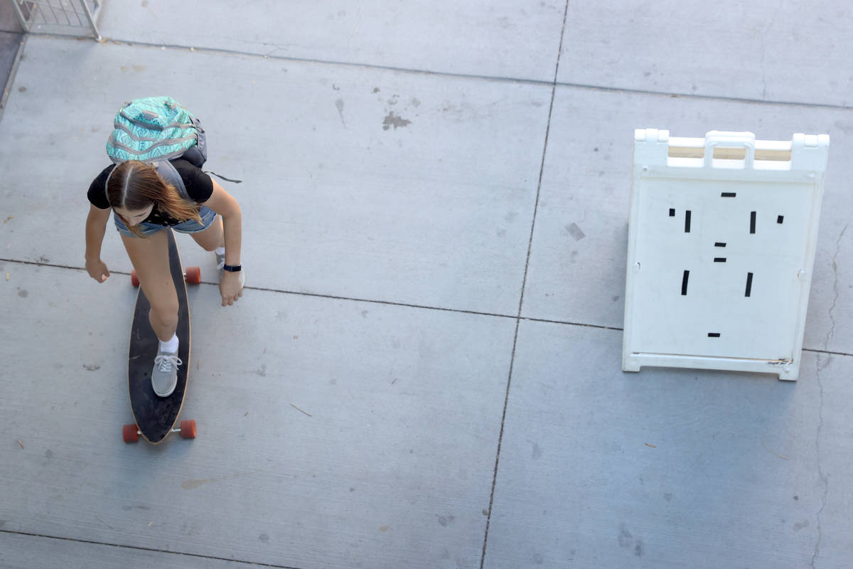 A person rides a skateboard to the Student Union at UNLV in Las Vegas, Friday, Sept. 4, 2020. ( ...