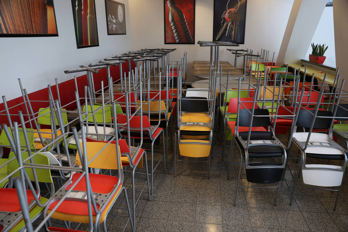 Chairs and tables are stored in a corner of the Student Union food court at UNLV in Las Vegas, ...