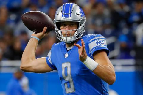 Detroit Lions quarterback Matthew Stafford throws against the New York Giants during an NFL foo ...