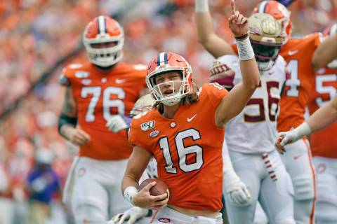 FILE - In this Oct. 12, 2019, filer photo, Clemson quarterback Trevor Lawrence (16) reacts afte ...