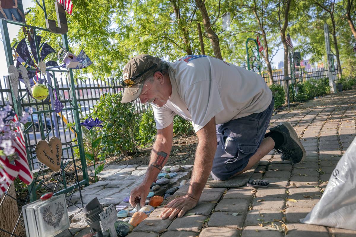 Caretaker of the Healing Garden Eddie Schmitz works Sept. 14 on memorial trellises for victims ...