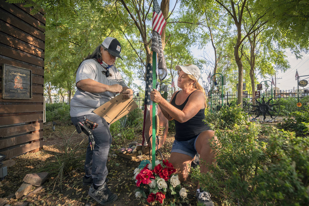 Healing Garden volunteers Sue Ann Cornwell, left, and Alicia Mierke work Sept. 14 on restoring ...