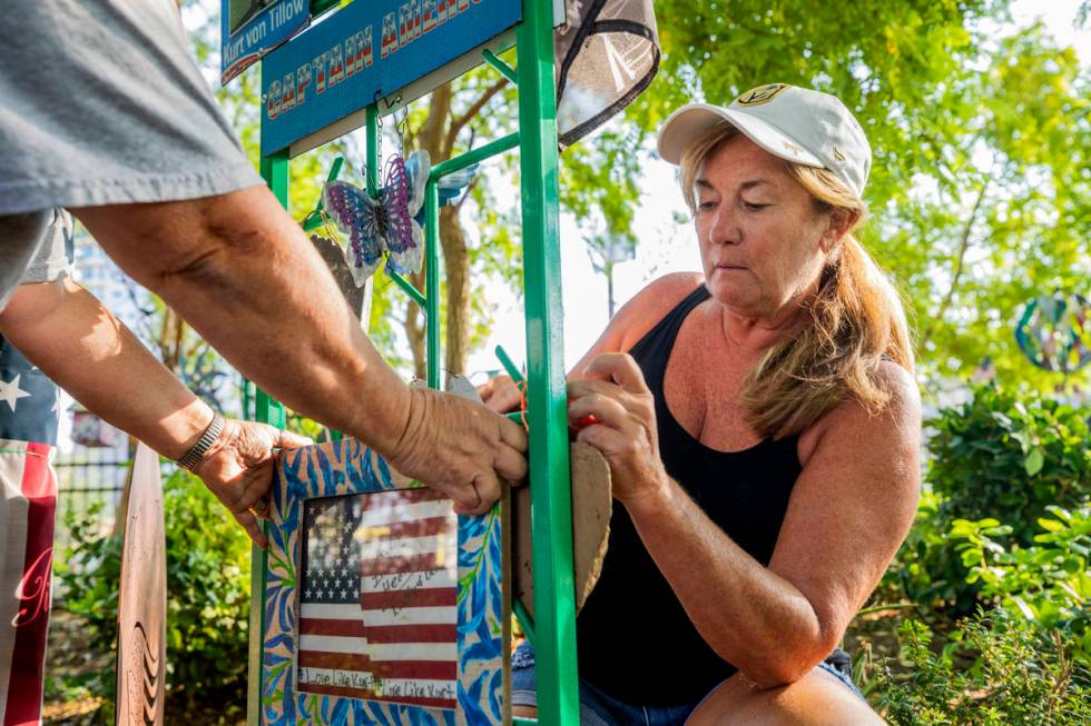 Volunteer Alicia Mierke works on a memorial trellis at the Healing Garden on Sept. 14. (Elizabe ...