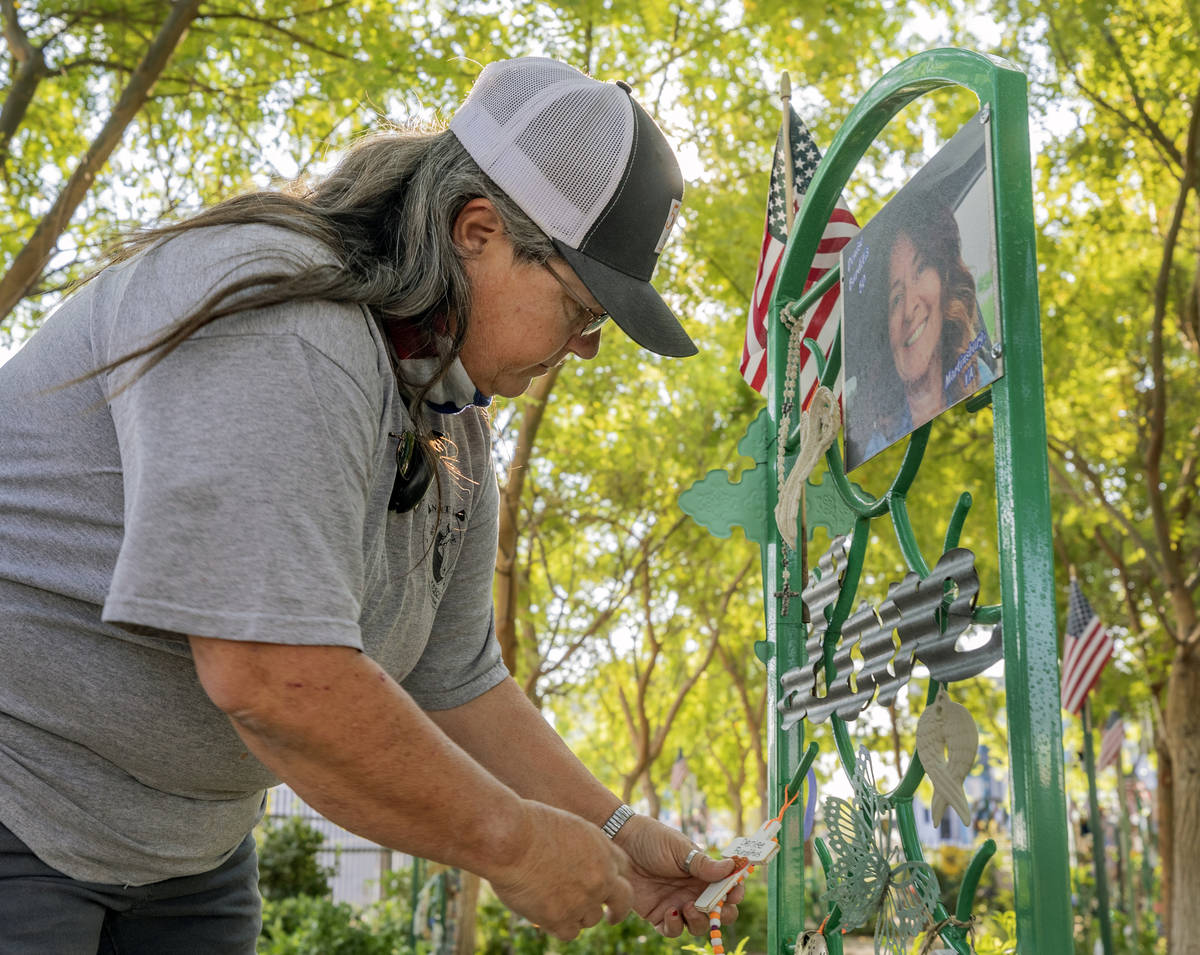 Survivor of Route 91 and caretaker of the Las Vegas Healing Garden Sue Ann Cornwell looks at Ro ...