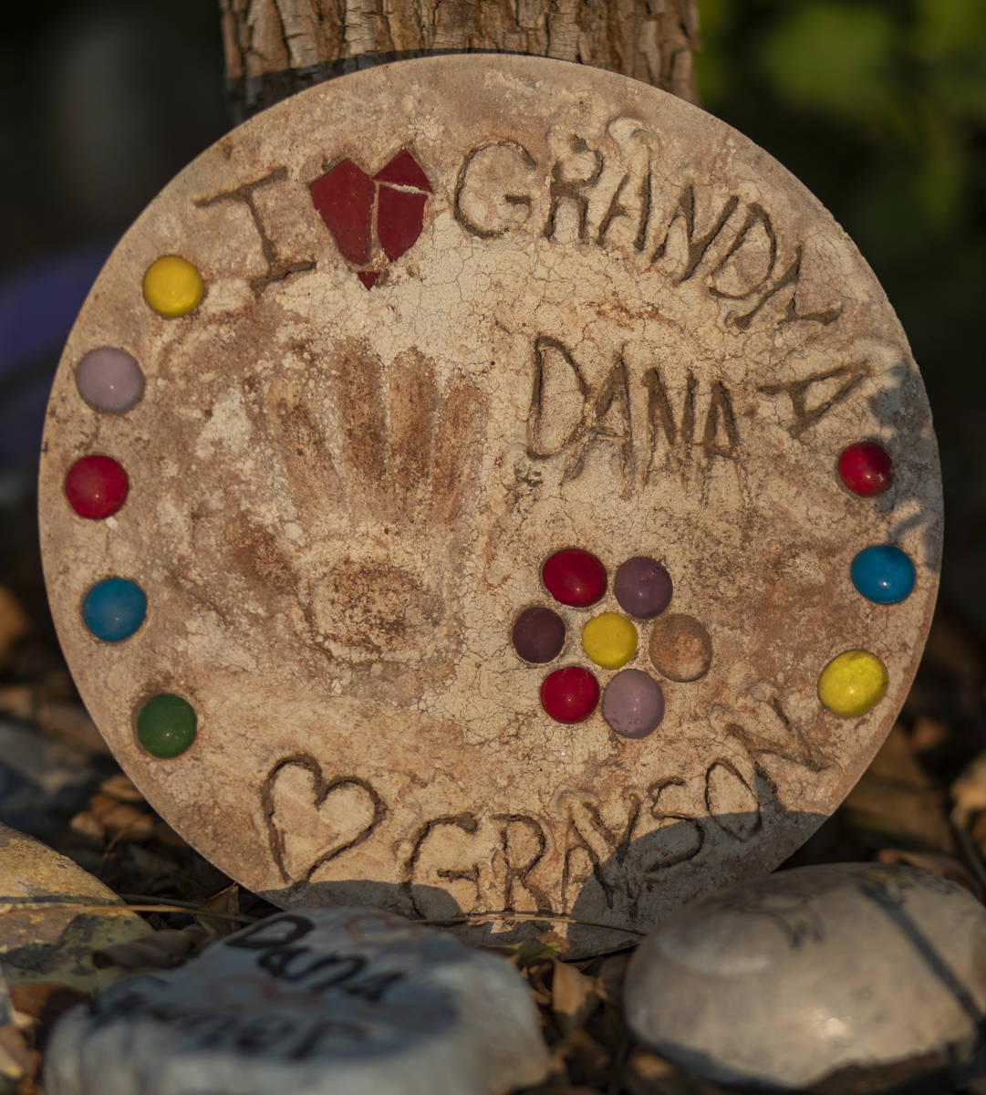 Relics seen around memorials for victims of Route 91, at the Las Vegas Healing Garden, in Las V ...
