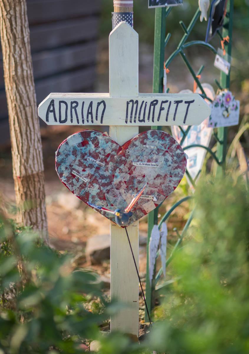 A cross stands as a memorial for Route 91 victim Adrian MurfittÕs at the Las Vegas Healing ...