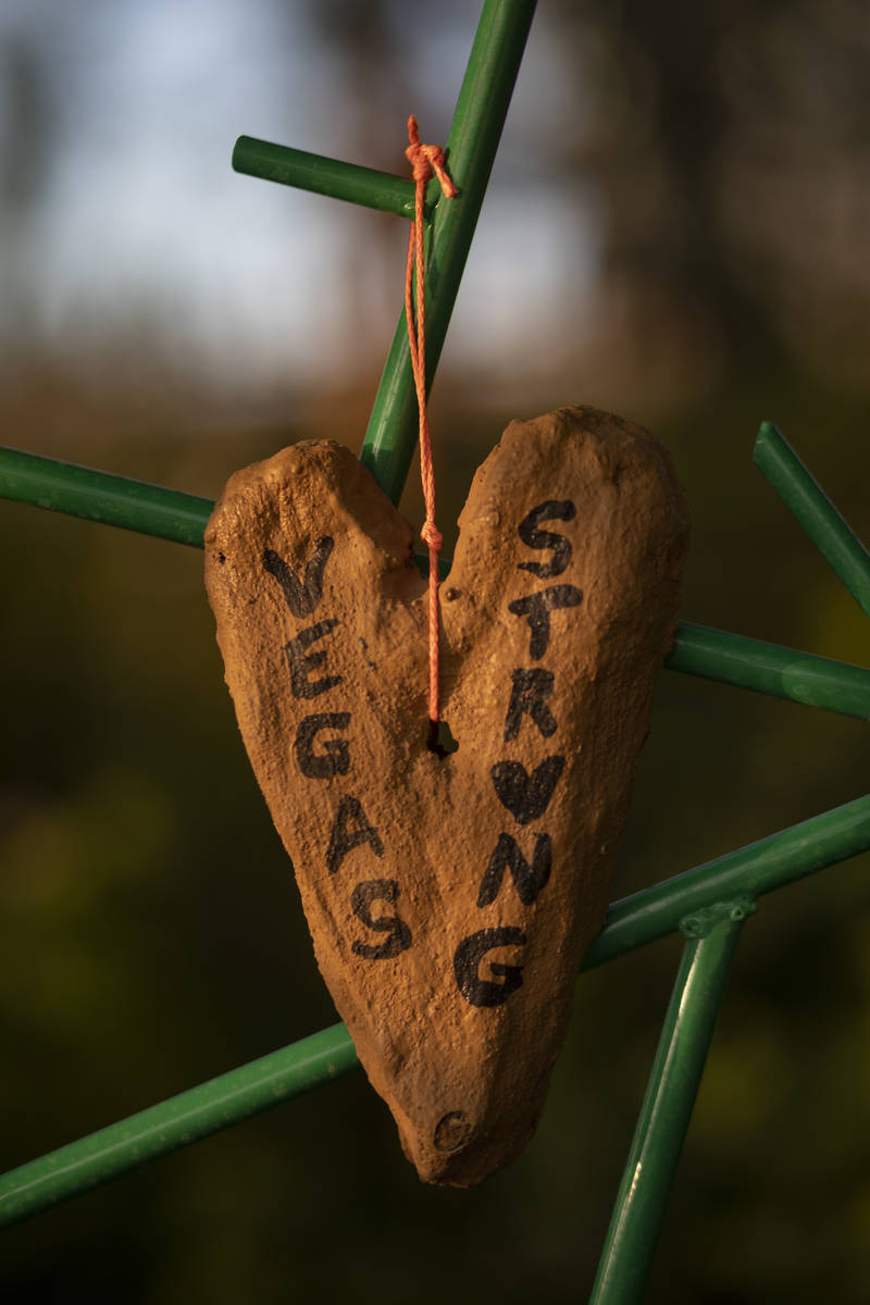 Relics seen adorning memorial trellises for victims of Route 91, at the Las Vegas Healing Garde ...