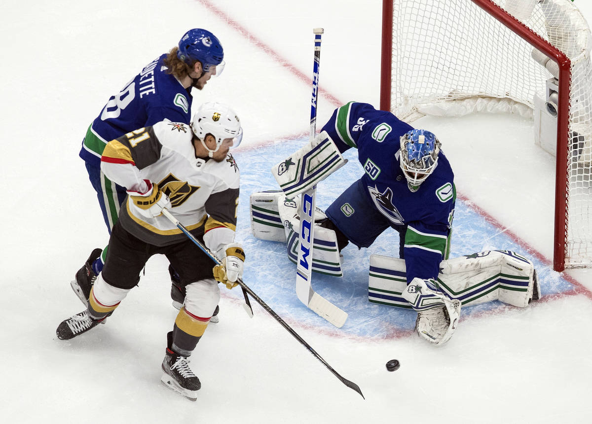 Vancouver Canucks goalie Thatcher Demko (35) makes a save against Vegas Golden Knights' Nick Co ...
