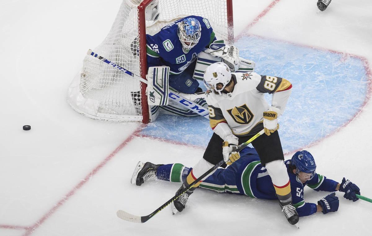 Vancouver Canucks goalie Thatcher Demko (35) makes a save on Vegas Golden Knights' Alex Tuch (8 ...
