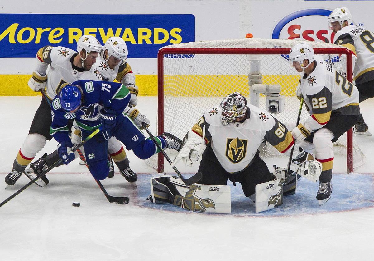 Vancouver Canucks' Tyler Toffoli (73) is stopped by Vegas Golden Knights goalie Robin Lehner (9 ...