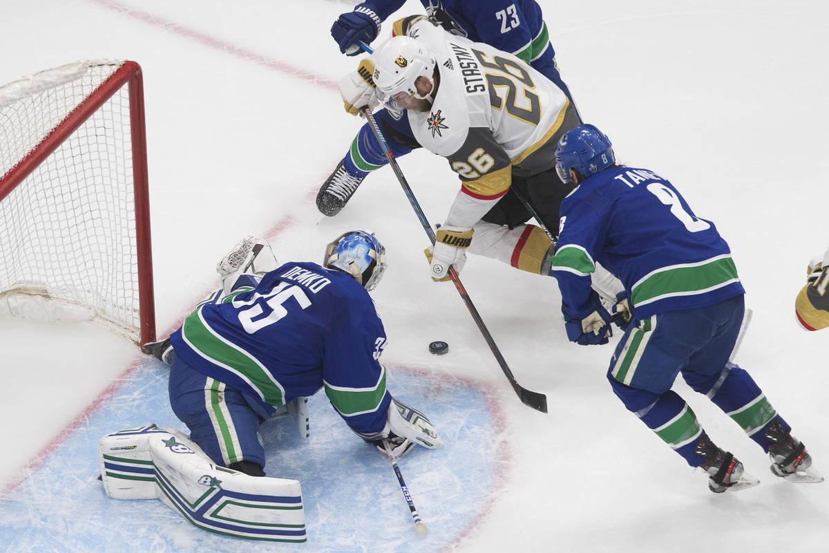 Vancouver Canucks goalie Thatcher Demko (35) makes a save on Vegas Golden Knights' Paul Stastny ...