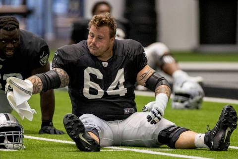 Las Vegas Raiders guard Richie Incognito (64) stretches with teammates during warm ups at the I ...