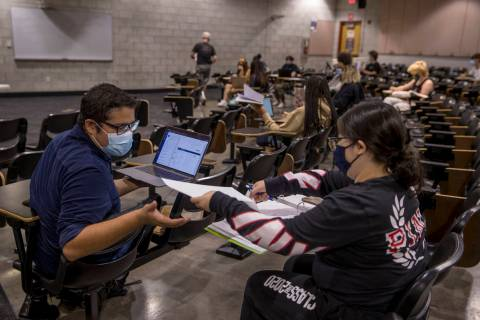 "UNLV pre-nursing freshman Jorge ""Fabian"" Trejo-Ibarra, left, works on a problem with fellow stu ..."