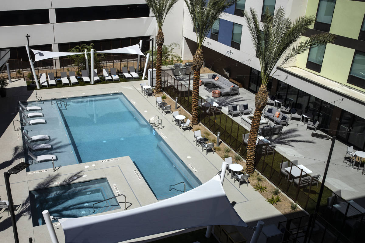 A swimming pool as seen from a newly built, dual branded Hampton Inn & Suites and Home2 Sui ...