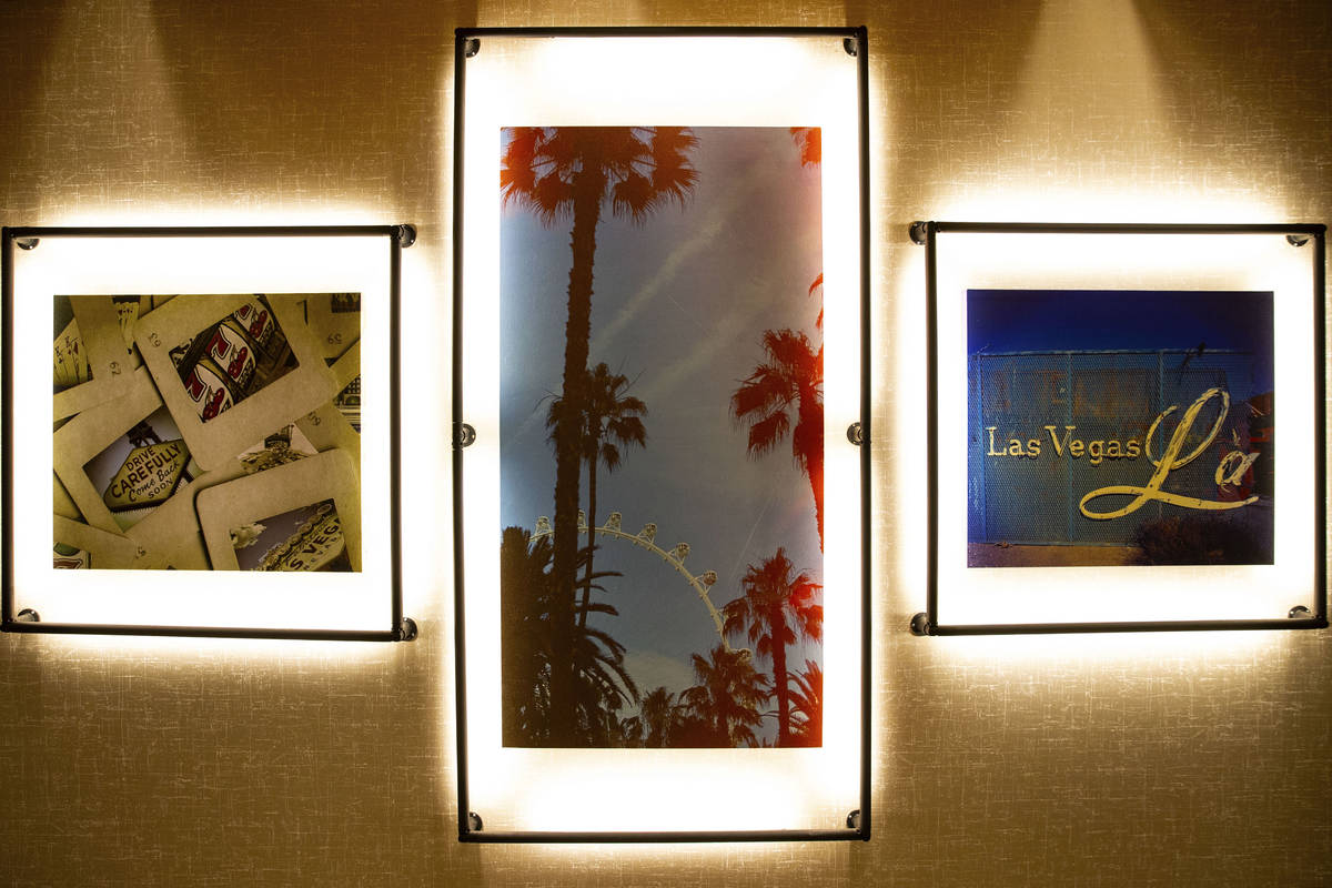 Wall decors are displayed at a newly built, dual branded Hampton Inn & Suites and Home2 Sui ...