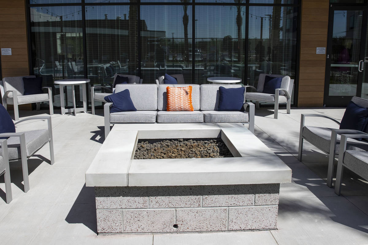 Rest area with fire pit at a newly built, dual branded Hampton Inn & Suites and Home2 Suite ...