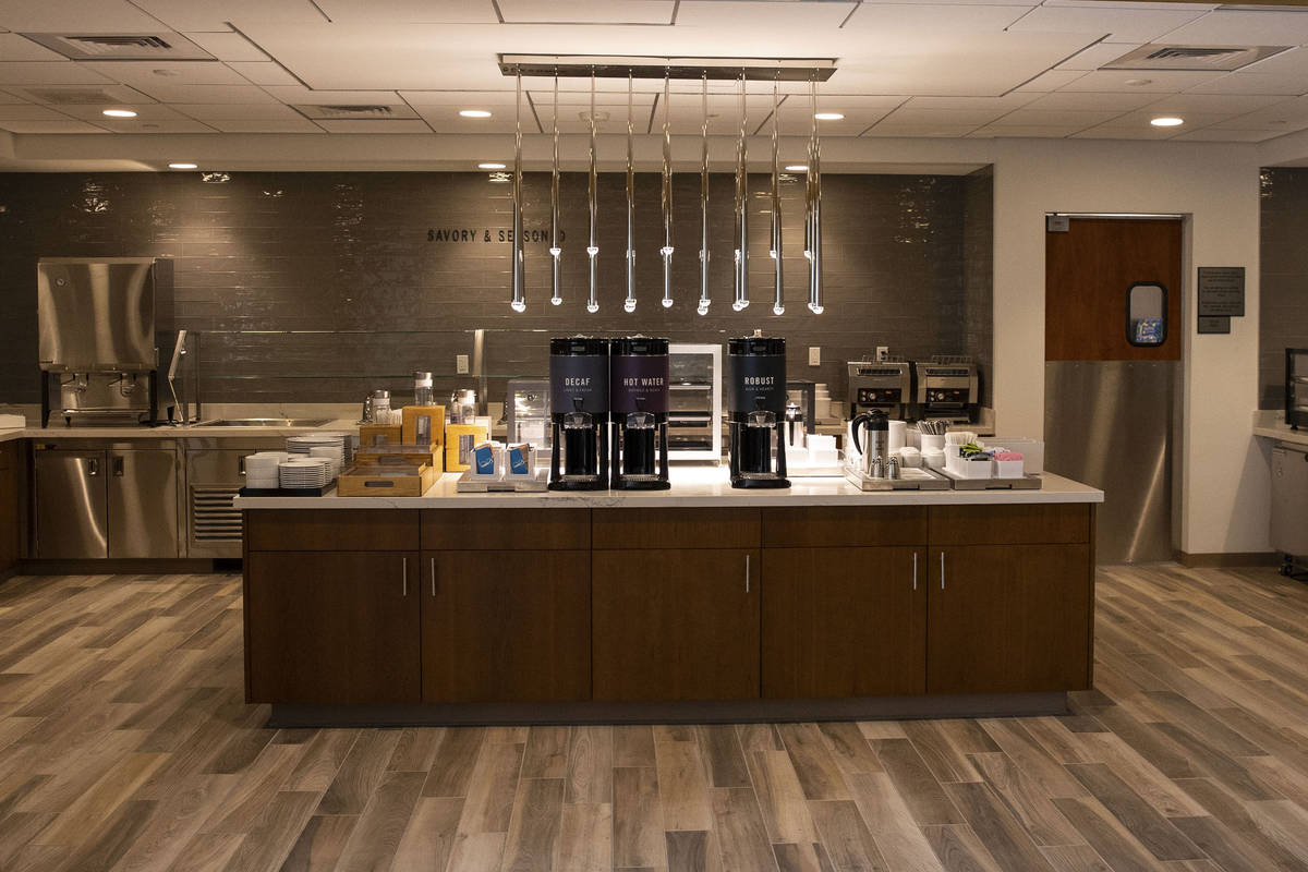 Breakfast area at displayed at a newly built, dual branded Hampton Inn & Suites and Home2 S ...