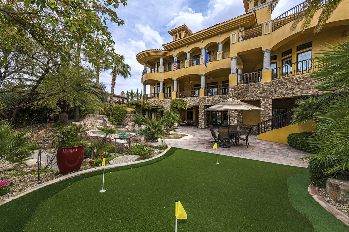 The Lake Las Vegas home has a putting green. It also sits on the lake and the golf course. (Eli ...
