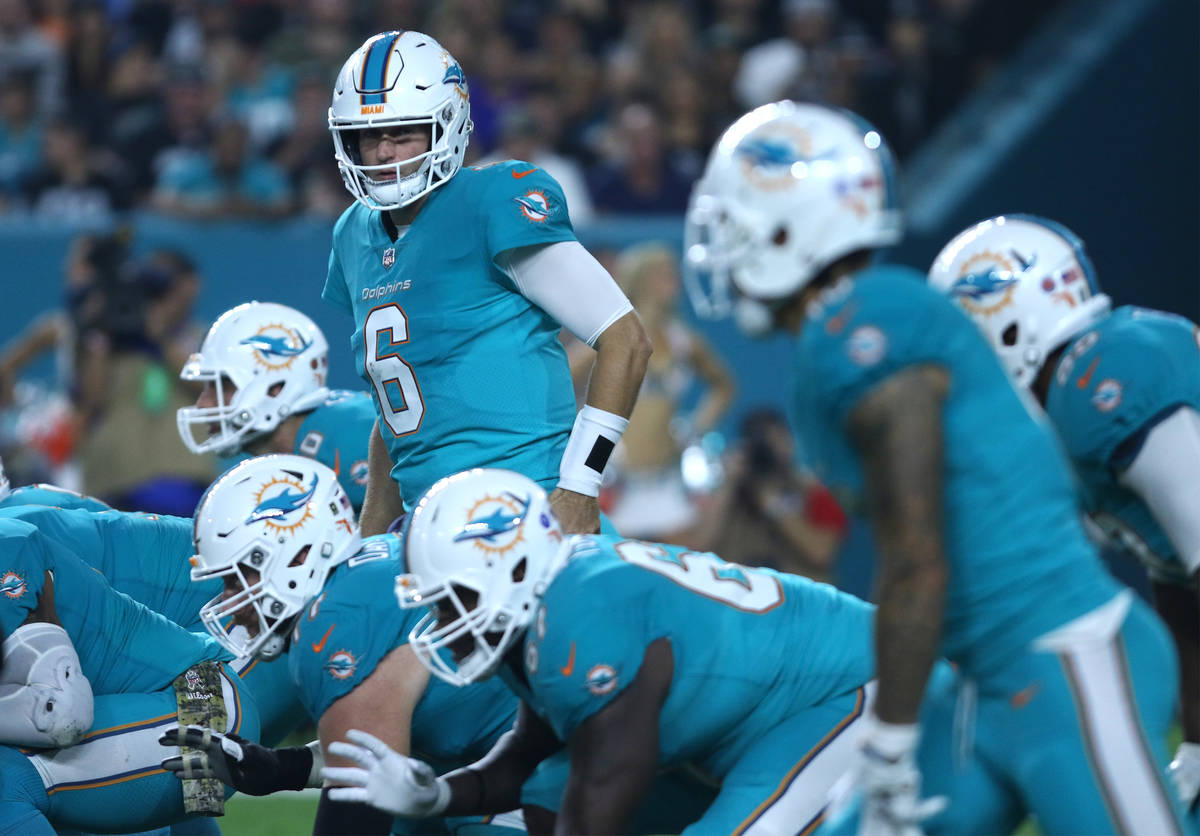 Miami Dolphins quarterback Jay Cutler (6) on the line of scrimmage during the first half of the ...