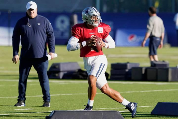Dallas Cowboys quarterback Dak Prescott (4) works a passing drill as head coach Mike McCarthy l ...