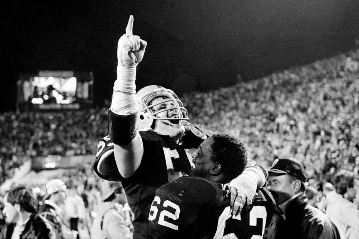 In this Jan. 23, 1984, file photo, Los Angeles Raiders' Matt Millen gestures as he celebrates w ...
