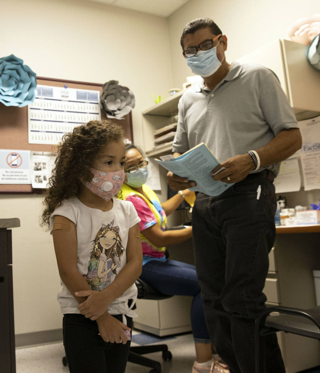 Jasmin Moreno, 4, leaves the room with her father Roberto Lopez after getting vaccinated as Vic ...