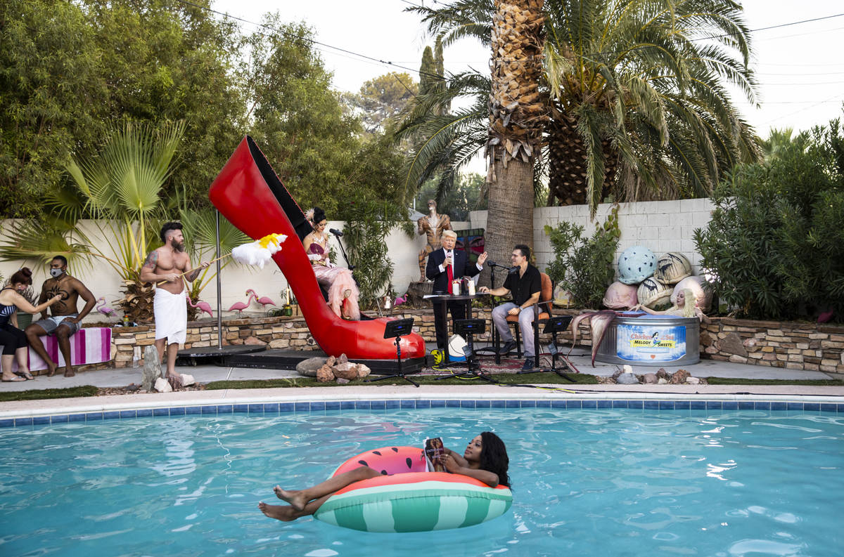 """A look at the poolside scene, with floating author Khalilah Yasmin reading from her book """"Matad ..."""