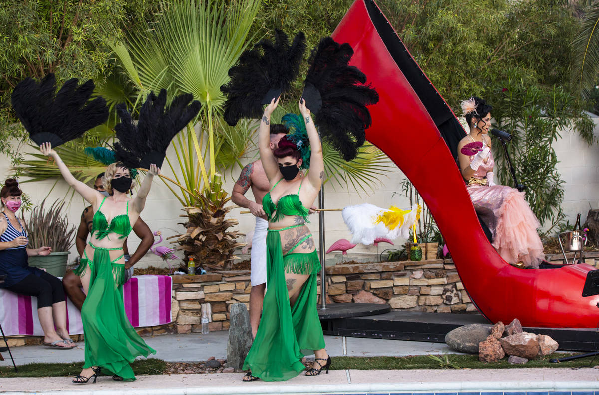 """Burlesque dancers Buttercup and Darby Fox are shown during the PodKats! """"End of Summer bash"""" wi ..."""