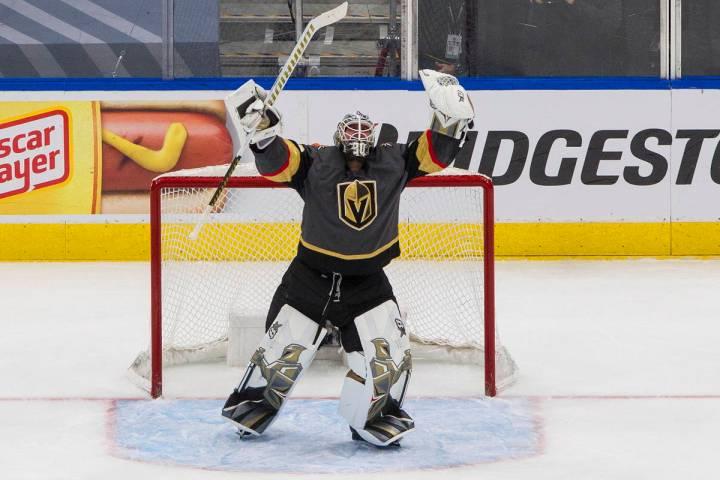 Vegas Golden Knights goalie Robin Lehner celebrates the team's win over the Vancouver Canucks i ...