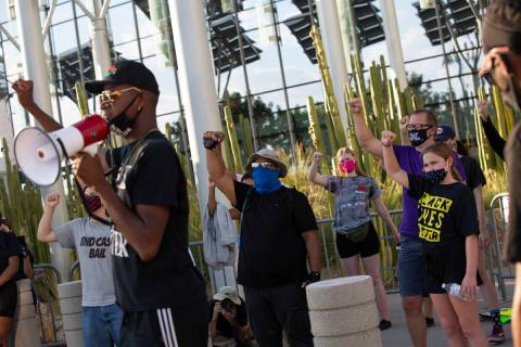 """Vance """"Stretch"""" Sanders leads chants for a group of protesters before marching at the ..."""