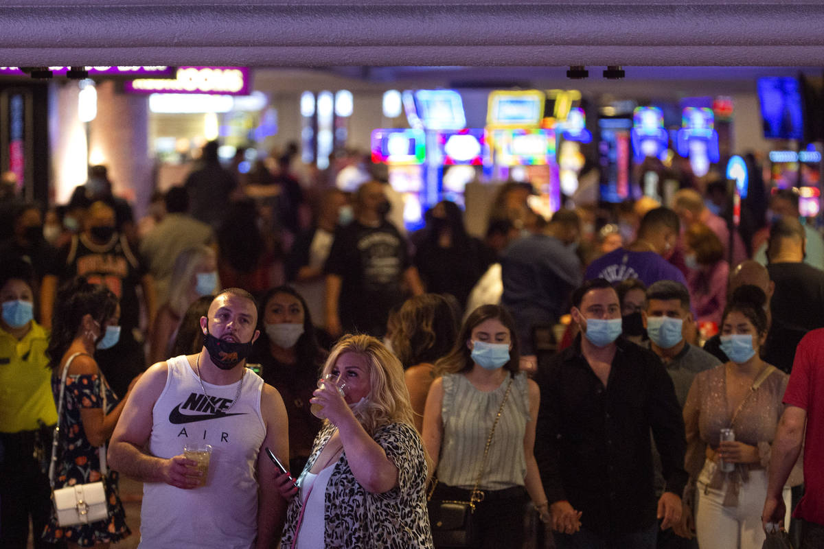 People mill in and out of Harrah's on the Strip during Labor Day weekend on Saturday, Sept. 5, ...