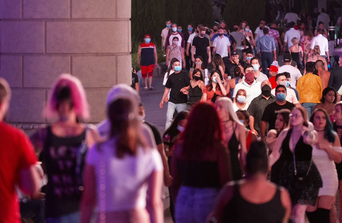 Visitors pass by The Forum Shops at Caesars on the Strip during Labor Day weekend on Saturday, ...