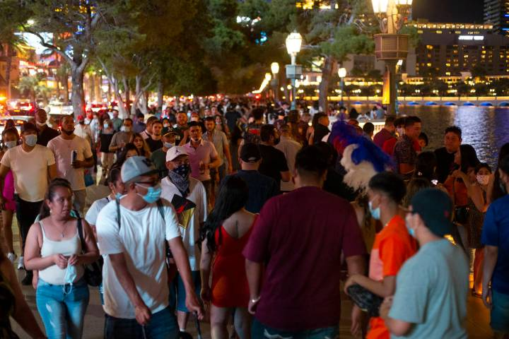 The Fountains of Bellagio on the Strip are crowed during Labor Day weekend on Saturday, Sept. 5 ...