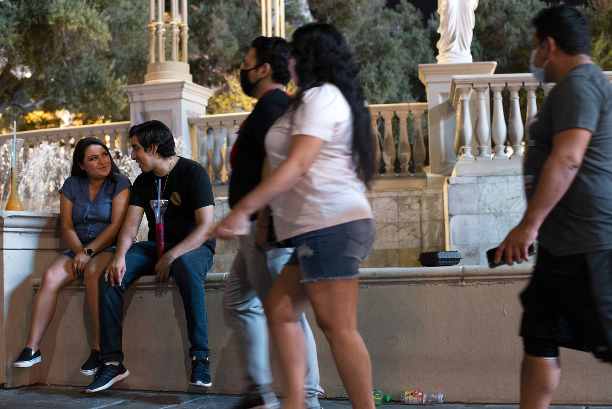 California couple Kristina Cruz and Hector Echeverria, left, share a moment outside Caesars Pal ...