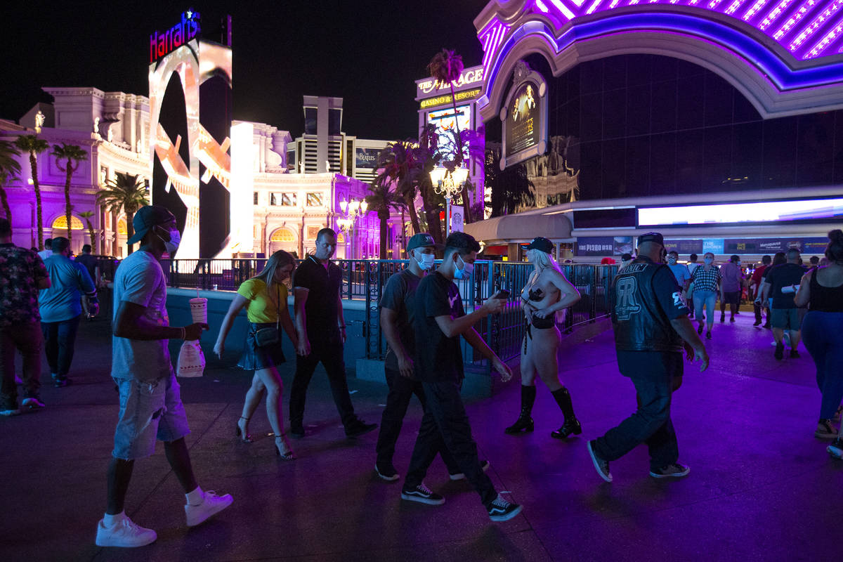 Visitors to the Strip pass by Harrah's and the LINQ during Labor Day weekend on Saturday, Sept. ...