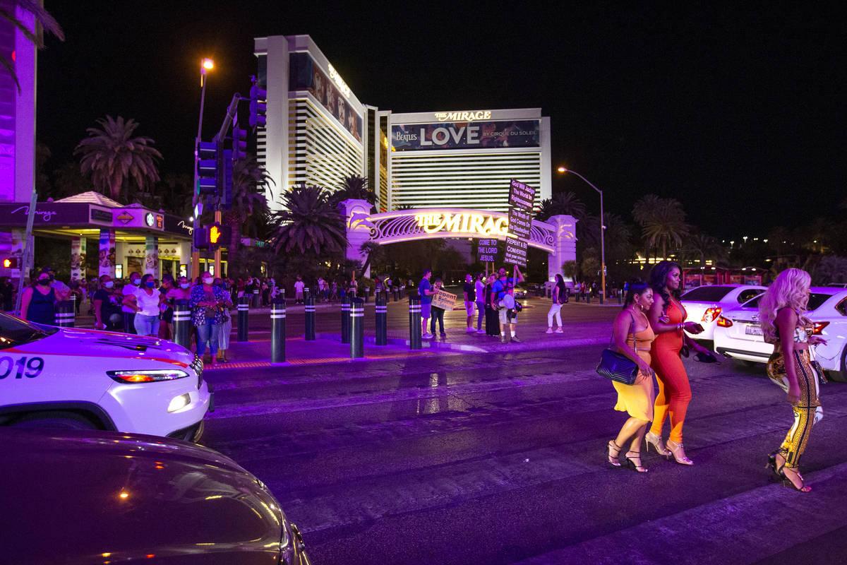 Las Vegas Strip visitors cross Las Vegas Boulevard outside The Mirage during Labor Day weekend ...