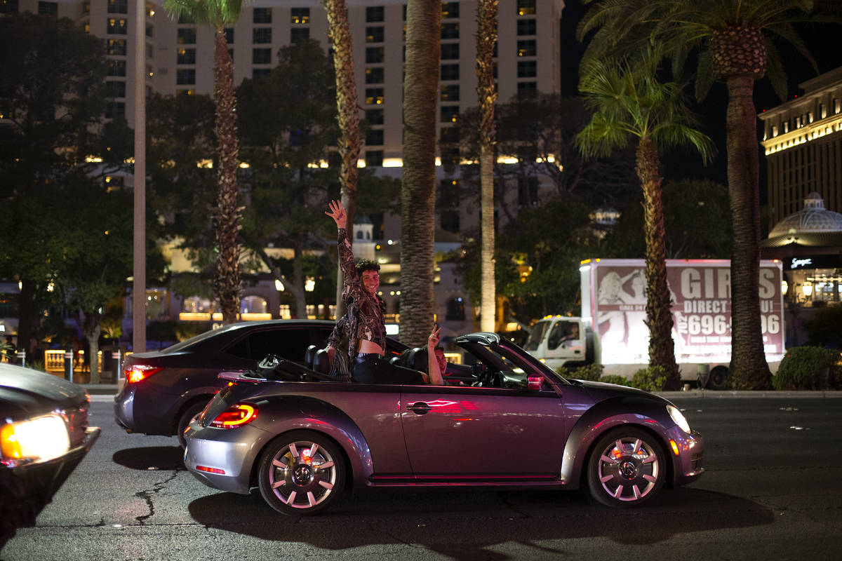 A visitor to the Strip cheers while driving down Las Vegas Boulevard during Labor Day weekend o ...