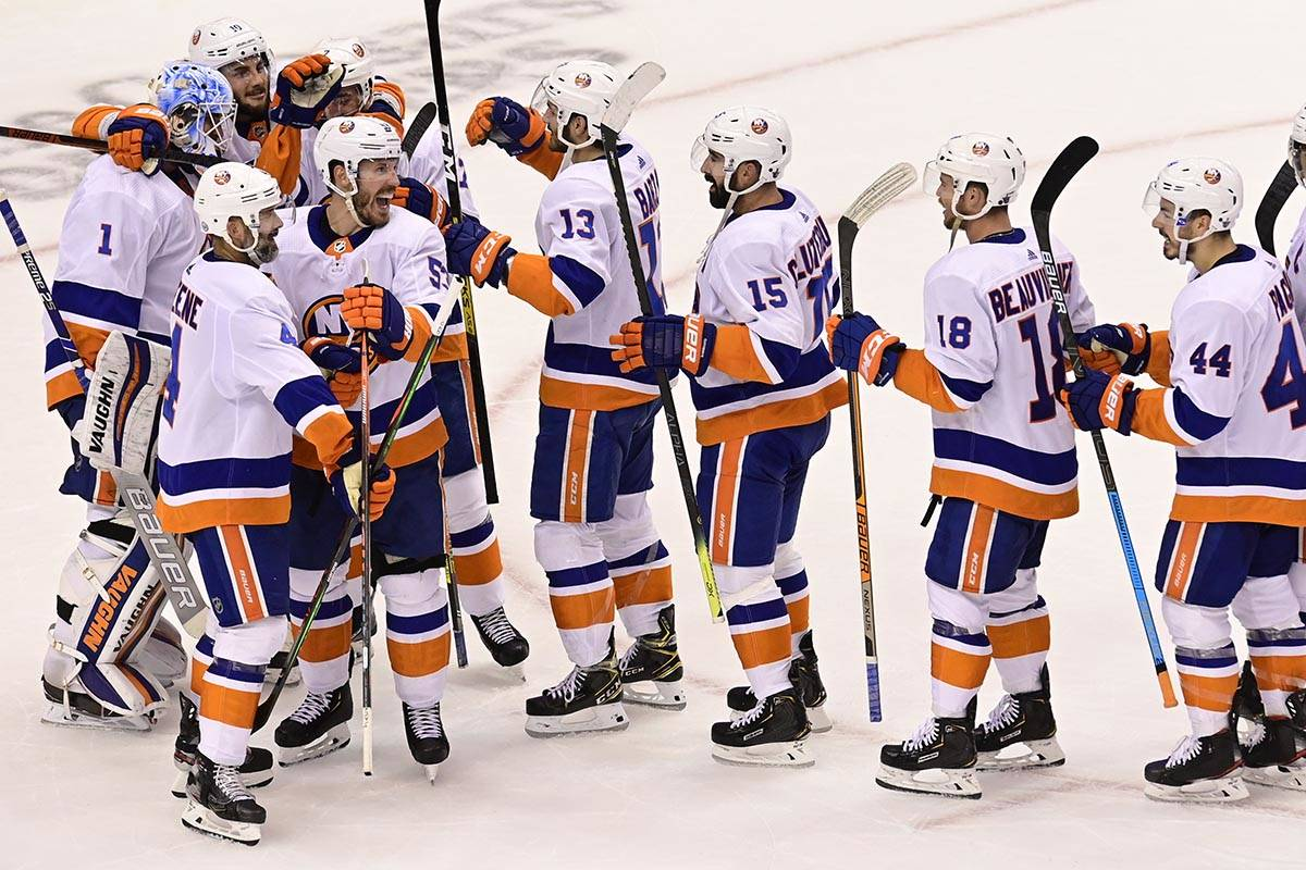 New York Islanders celebrate defeating the Philadelphia Flyers after third-period NHL Stanley C ...