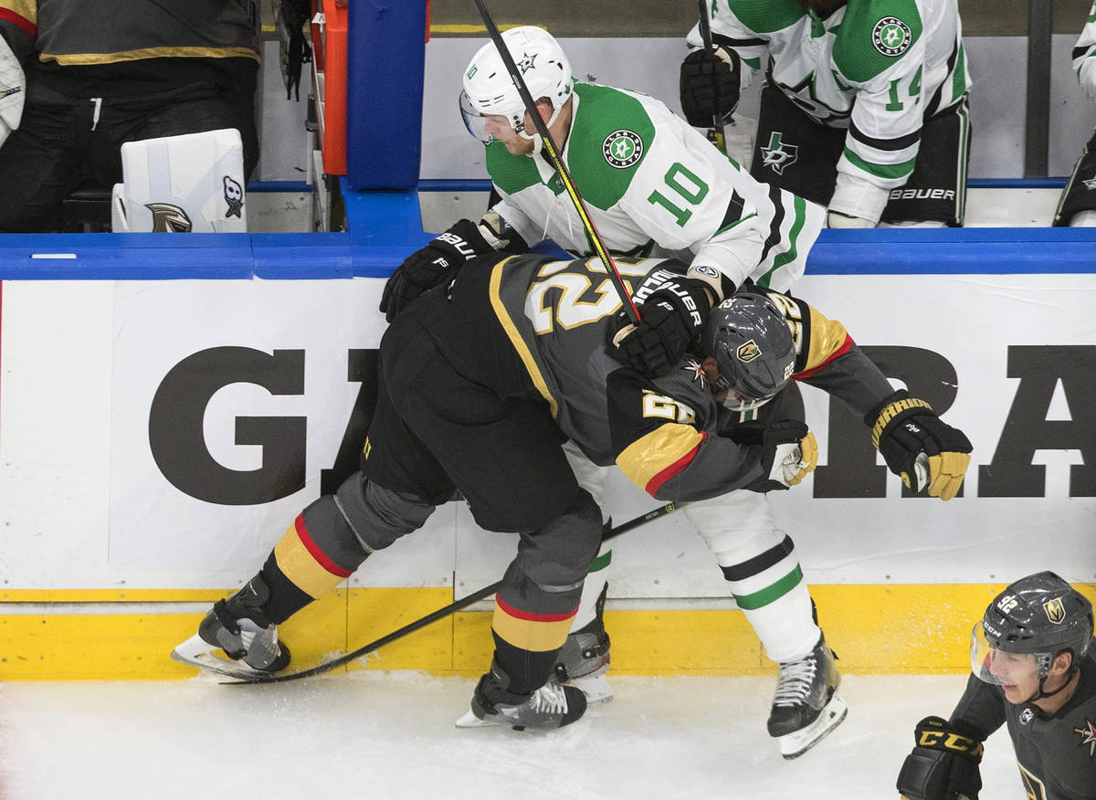 Vegas Golden Knights' Paul Stastny (26) checks Dallas Stars' Corey Perry (10) during the first ...