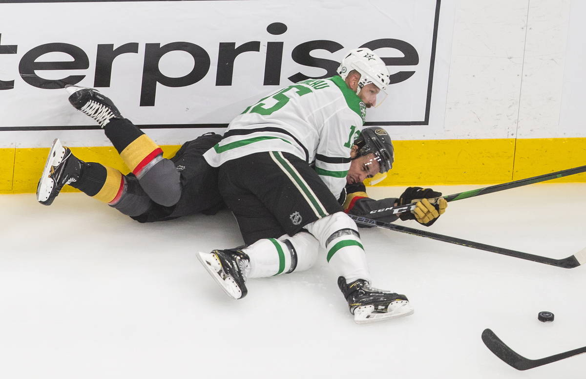 Vegas Golden Knights' Reilly Smith (19) is checked by Dallas Stars' Blake Comeau (15) during th ...