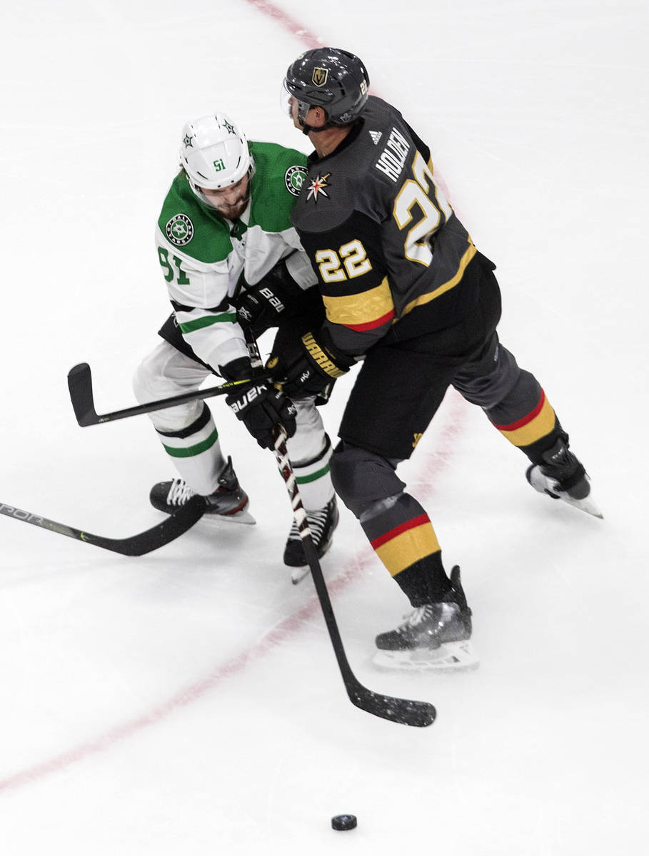 Vegas Golden Knights' Nick Holden (22) and Dallas Stars' Tyler Seguin (91) battle for the puck ...