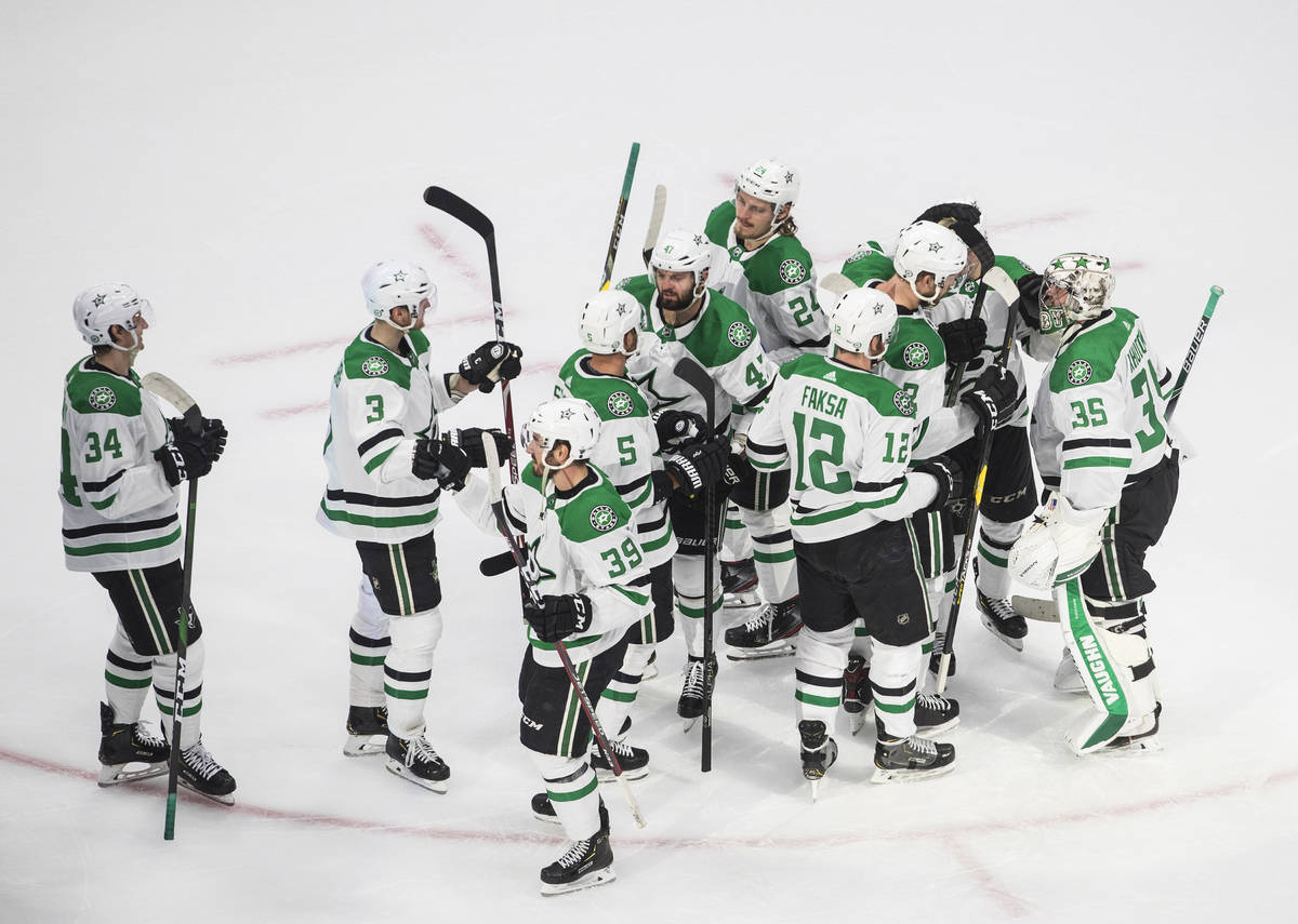 Dallas Stars players celebrate their 1-0 win over the Vegas Golden Knights after an NHL Western ...