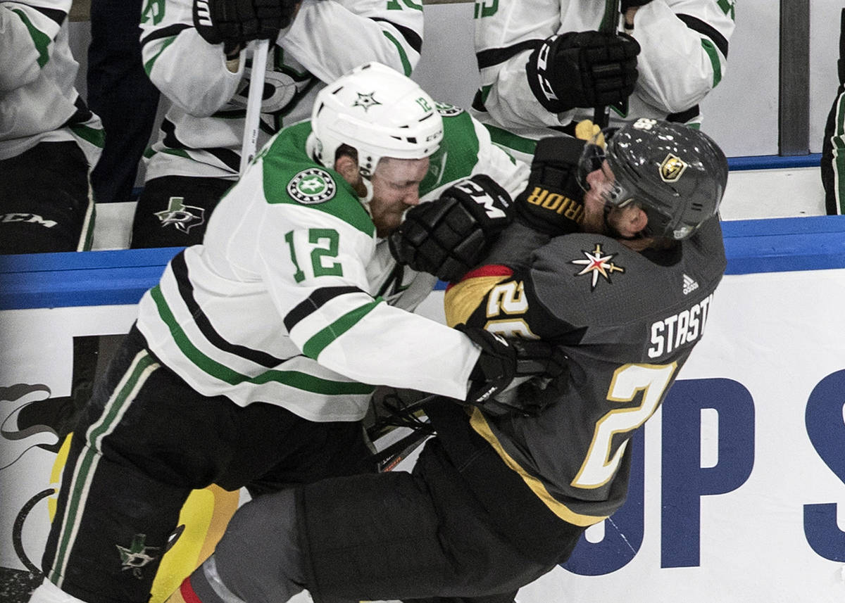 Vegas Golden Knights' Paul Stastny (26) is checked by Dallas Stars' Radek Faksa (12) during the ...